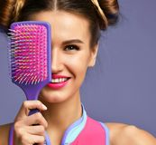 Happy fashion brunette woman close eyes with colorful pink blue big hair comb brush. Closeup portrait of happy fashion brunette woman close eyes with colorful stock image