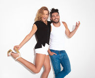 Happy fashion couple celebrating together. While smiling at the camera Royalty Free Stock Photo