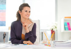 Happy fashion designer in office. Looking on copy space stock photo