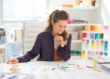 Happy fashion designer working in office. Happy fashion designer working in modern office royalty free stock image