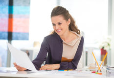 Happy fashion designer working in office Royalty Free Stock Photo