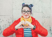 Happy fashion hipster woman with colorful hair showing heart by. Happy beautiful fashion hipster woman with colorful hair showing heart by hands stock photo