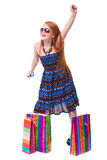 Happy fashion little redhead girl with shopping bags. Royalty Free Stock Images