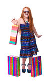 Happy fashion little redhead girl with shopping bags. Stock Photos
