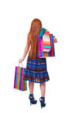 Happy fashion little redhead girl with shopping bags. Royalty Free Stock Photo