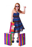 Happy fashion little redhead girl with shopping bags. Royalty Free Stock Photography
