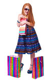 Happy fashion little redhead girl with shopping bags. Stock Photography
