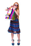 Happy fashion little redhead girl with shopping bags. Royalty Free Stock Image