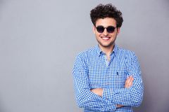 Happy fashion man standing with arms folded Royalty Free Stock Photo