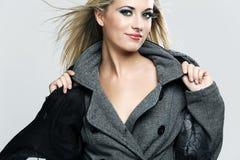 Happy fashion model posing in studio. Royalty Free Stock Photography