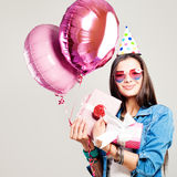 Happy Fashion Model Woman with Holiday Balloons and Birthday Gif Royalty Free Stock Image