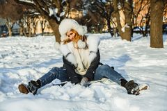 Happy fashion model woman in winter park outdoor stock photo
