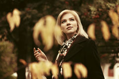 Happy fashion woman in classic coat walking outdoor Royalty Free Stock Photo