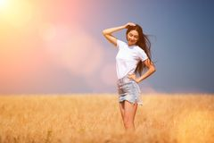 Happy fashion woman enjoying the life in the field stock image