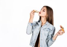 Happy fashion woman holding a piece of pizza. Girl eating pizza Stock Photos