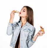 Happy fashion woman holding a piece of pizza. Girl eating pizza Royalty Free Stock Image