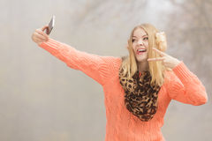 Happy fashion woman in park taking selfie photo. Royalty Free Stock Photos