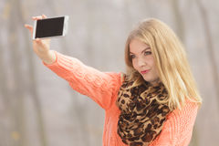 Happy fashion woman in park taking selfie photo. Royalty Free Stock Images