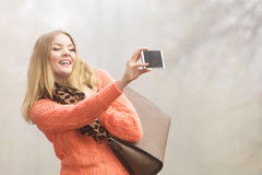 Happy fashion woman in park taking selfie photo. Royalty Free Stock Photo
