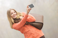 Happy fashion woman in park taking selfie photo. Royalty Free Stock Image