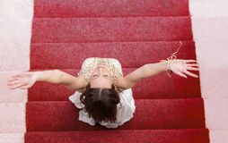 Happy fashion woman profile breathing deep fresh air on stairway Stock Image