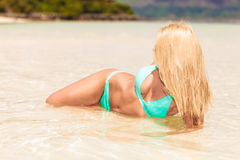 Happy fashion woman rest on the beach Royalty Free Stock Photos