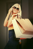 Happy fashion woman with shopping bags calling on mobile phone Royalty Free Stock Images
