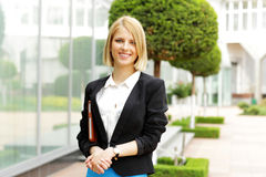 Happy fashion woman standing outdoors Stock Photo