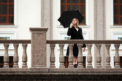 Happy fashion woman with umbrella Stock Photography
