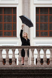 Happy fashion woman with umbrella in a rain Royalty Free Stock Photo