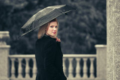 Happy fashion woman with umbrella in the rain Royalty Free Stock Photo