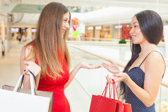Happy fashion women with bags indoor at the shopping center Stock Photo