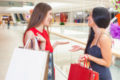 Happy fashion women with bags indoor at the shopping center Stock Images