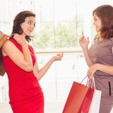 Happy fashion women with bags indoor at the shopping center Stock Photography