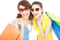 Happy fashion young sisters with shopping bags Stock Images