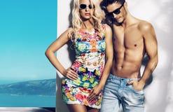 Happy fashionable couple on sunny vacation day. Glad fashionable couple on sunny vacation day Royalty Free Stock Photo