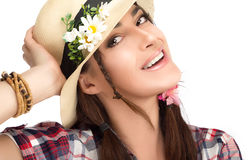 Happy Fashionable Woman Wearing a Hat with Flowers Royalty Free Stock Photography