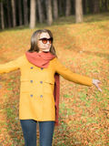 Happy  fashionable young woman walking  in autumn park Royalty Free Stock Photography