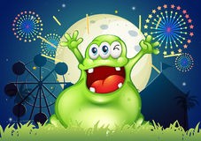 A happy fat green monster at the amusement park Royalty Free Stock Image