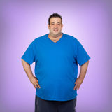 Happy fat man with blue shirt Stock Photography