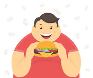 Happy fat man eating a big hamburger Royalty Free Stock Photography