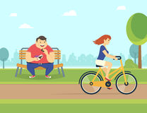Happy fat man eating chocolate in the park and looking at pretty woman riding a bicycle. Happy fat man eating a chocolate sitting in the park on the bench  and Royalty Free Stock Images