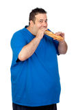 Happy fat man eating a large bread stock photography