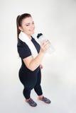 Happy fat woman in sportswear drinking water Royalty Free Stock Image
