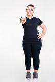 Happy fat woman in sportswear pointing finger at camera Royalty Free Stock Images