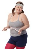 Happy fat woman with tape measure Royalty Free Stock Image