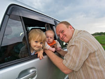 Happy father and 2 baby daughters Royalty Free Stock Photos