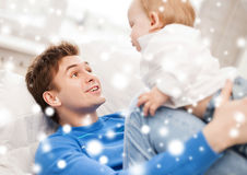 Happy father with adorable baby. Family, children, christmas, x-mas, love concept - happy father with adorable baby Royalty Free Stock Images