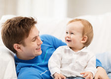 Happy father with adorable baby Stock Photo