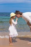 Happy father and adorable little daughter at white Stock Photo